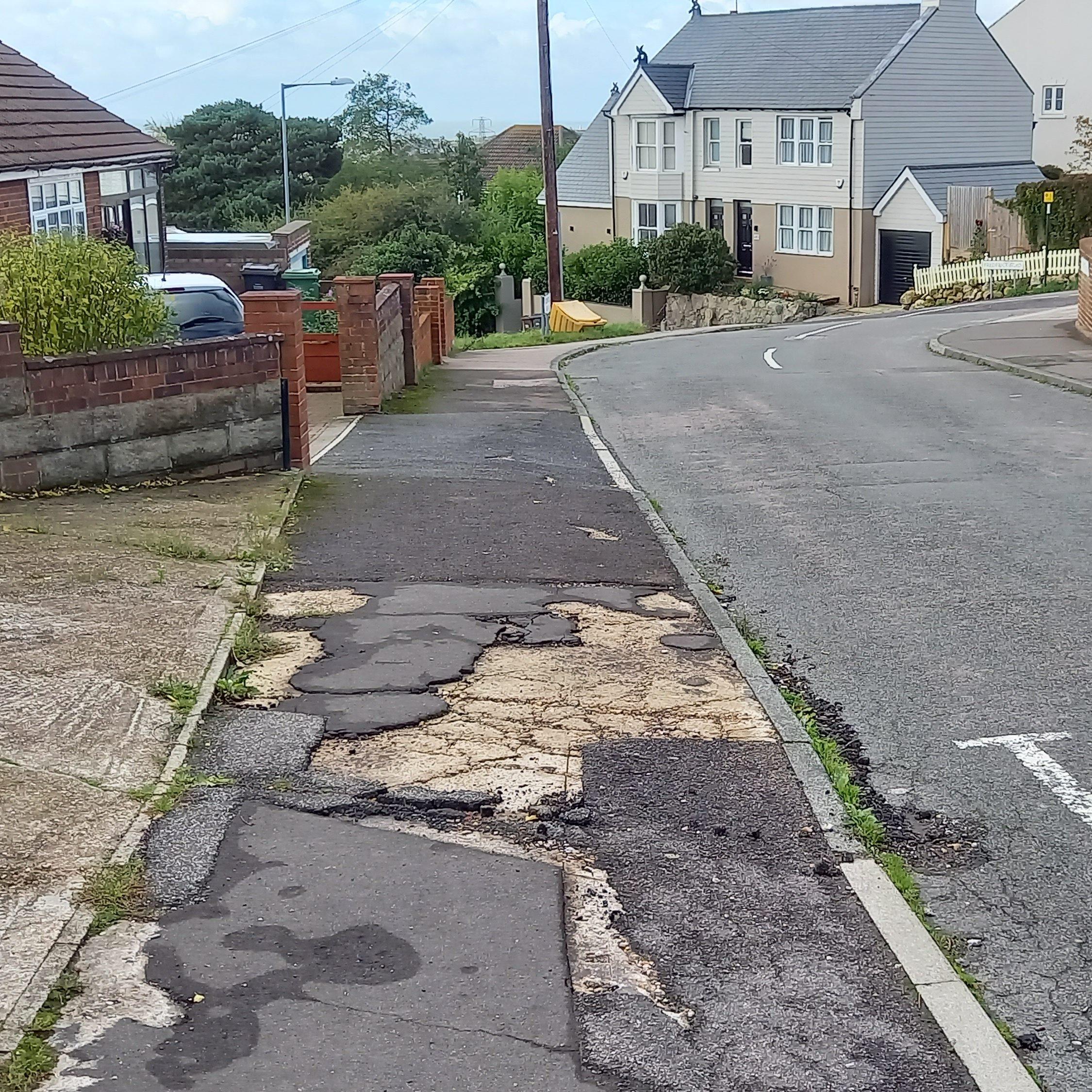 Damaged footways in Coghurst Road