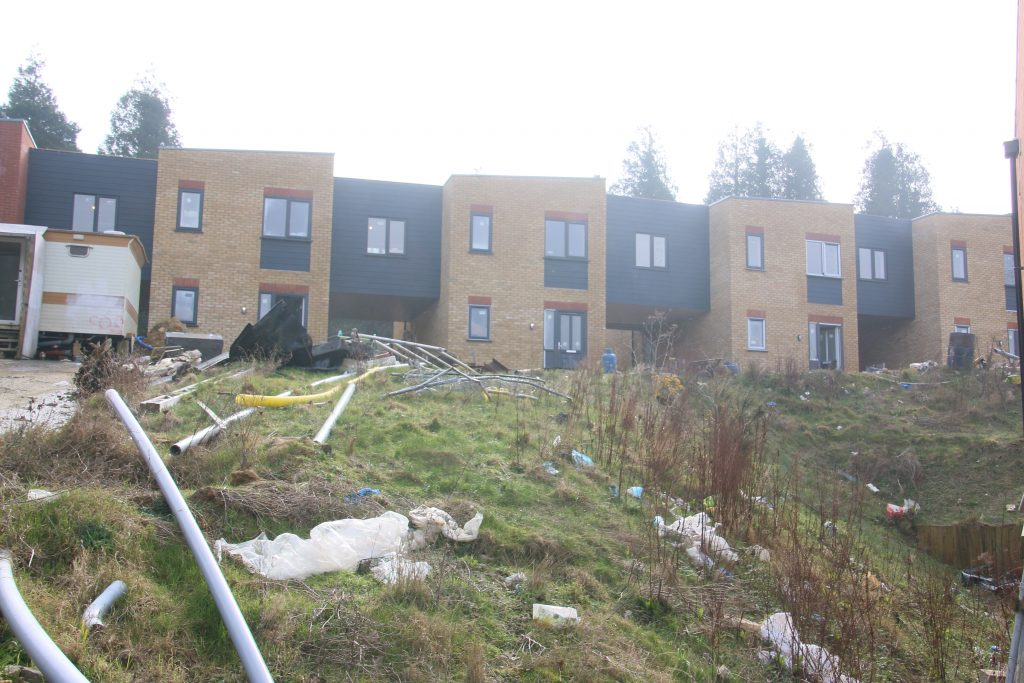 Terraced housing on untidy building site