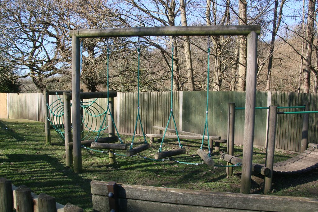 Play equipment - adventure trail made from suspended logs.