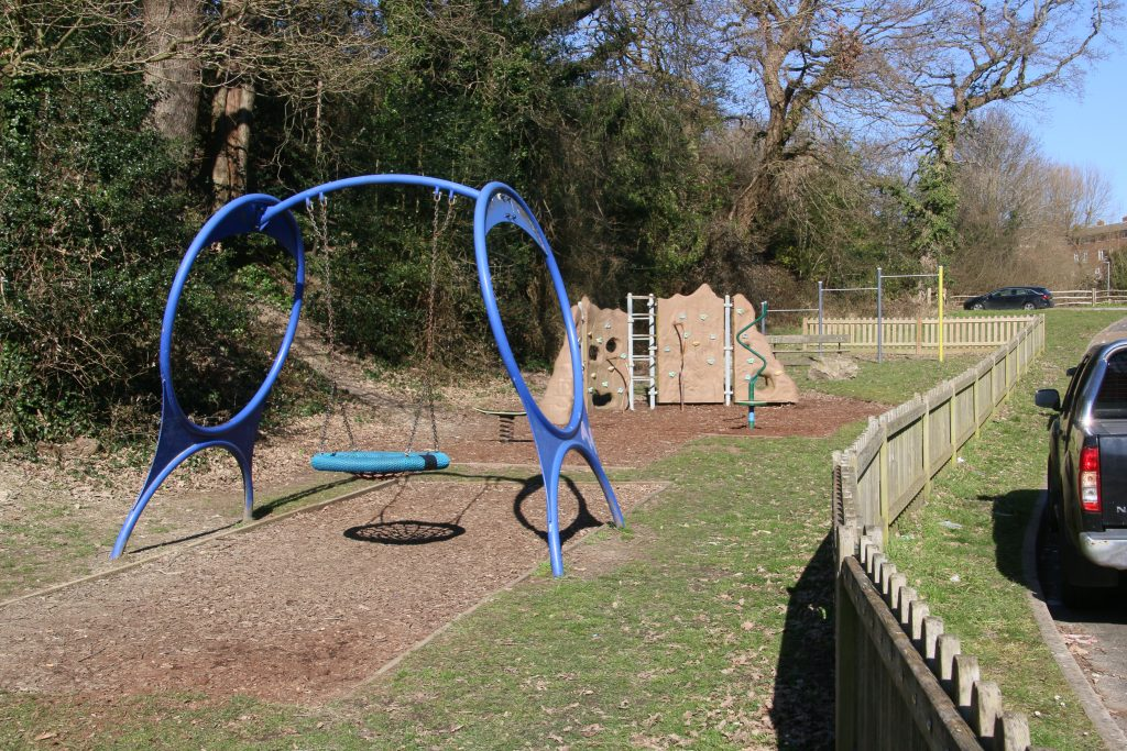 Waterside Close play area - swings and climbing wall