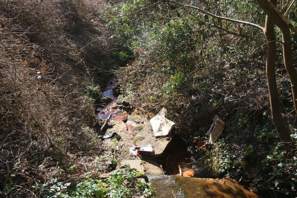 Waterside Close culvert, stream at bottom of steep sided cutting