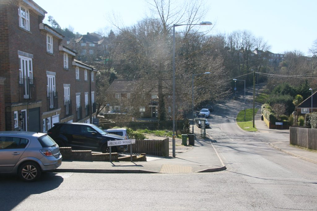 Frederick Road, view downhill, town houses with cars in driveways.