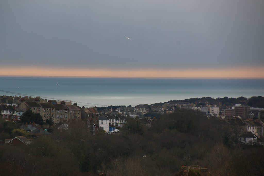 View out to sea, layers of colour of sea and sky