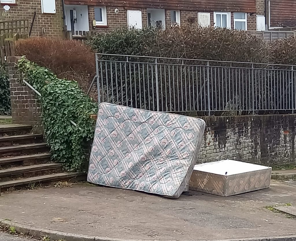 Flytipped mattress and bed by steps