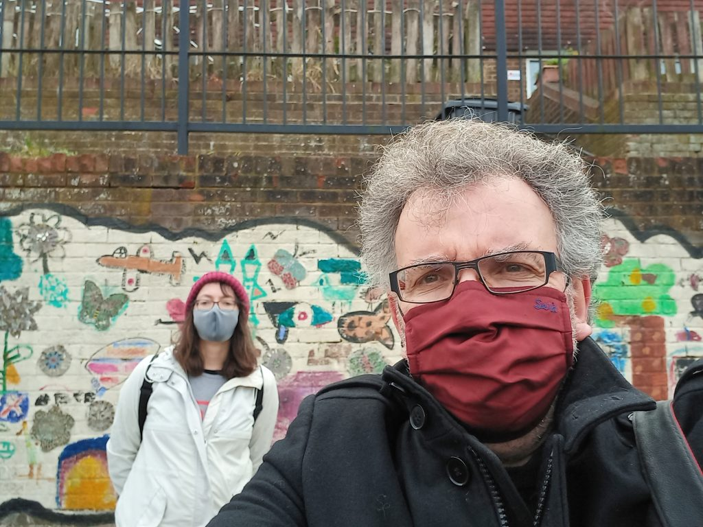 Ali Roark and Peter Chowney, socially distanced selfie, with masks