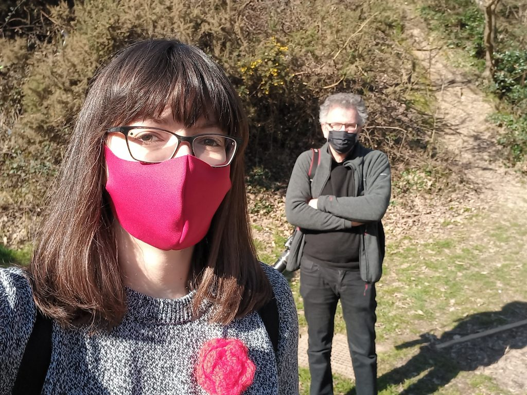 Socially distanced selfie of Ali Roark and Peter Chowney, in face masks