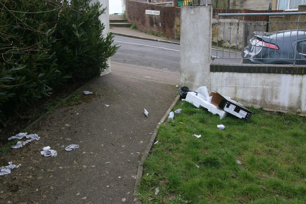 Litter on grass and path in School Road community garden