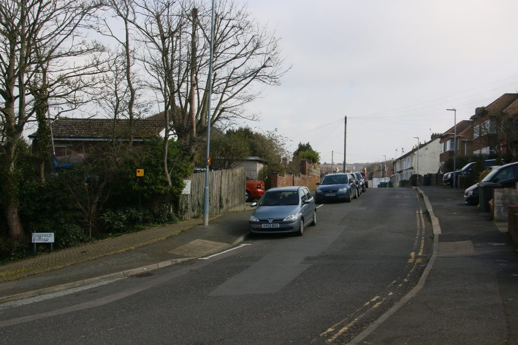 Oakfield Road, cars parked beside road with trees